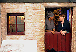 DINGLE MONDAY 4-5-09: Her Excellency Ms. Mannete Ramaili, Ambassador of the Kingdom of Lesotho Ireland and St. Stanislaus Kennedy, champion of social justice take time out from the political symposium on 'The Change' to relax in the 'king's home', a recreation from the island king's house on the island which is on display at The Blasket Island Interpretive Centre in Dun Chaoin, Dingle at the conclusion of Feile na Bealtaine on Monday.<br /> Picture by Don MacMonagle
