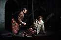 """London, UK. 09.03.2016. English Touring Opera presents """"Don Giovanni"""", by Wolfgang Amadeus Mozart, at the Hackney Empire.  Directed by Lloyd Wood, with set & costume design by Anna Fleischle and lighting design by Guy Hoare. Picture shows:  Robyn Lyn Evans (Don Ottavio), Camilla Roberts (Donna Anna). Photograph © Jane Hobson."""