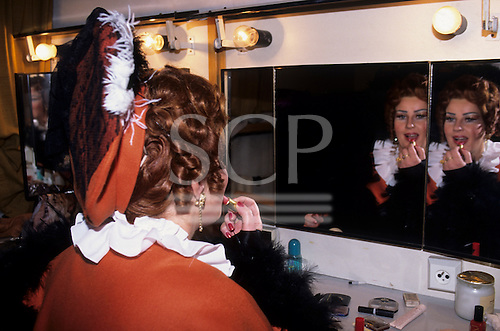 Bratislava, Slovakia. Behind the scenes at the National Opera: a performer applies her make-up.