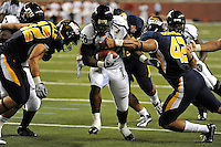 26 December 2010:  FIU running back Darriet Perry (28) runs for a touchdown in second half as the FIU Golden Panthers defeated the University of Toledo Rockets, 34-32, to win the 2010 Little Caesars Pizza Bowl at Ford Field in Detroit, Michigan.