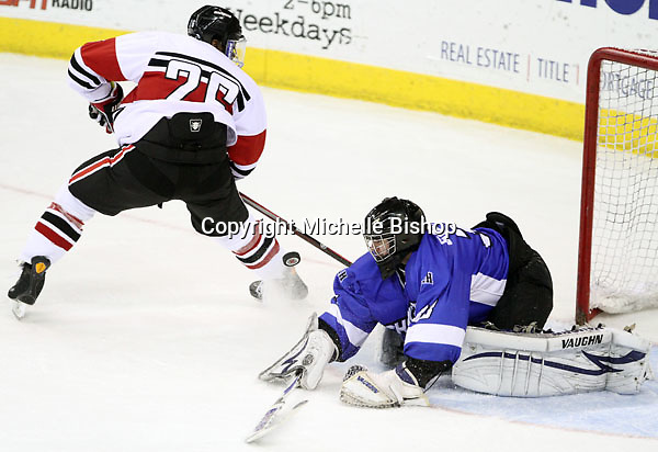 Alabama-Huntsville goalie Clarke Saunders makes a stop on a breakaway by UNO's Alex Hudson during the second period. Saunders finished with 58 saves. Alabama-Huntsville beat UNO 2-1 in overtime Saturday night at Qwest Center Omaha. (Photo by Michelle Bishop)