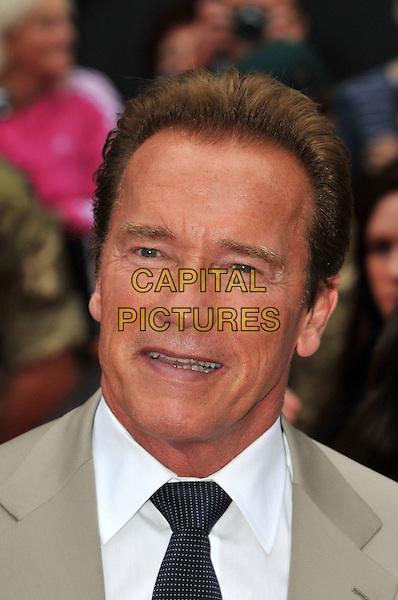 Arnold Schwarzenegger.The 'The Expendables 2' UK film premiere, Empire cinema, Leicester Square, London, England..August 13th, 2012.headshot portrait beige suit jacket black tie white shirt .CAP/BF.©Bob Fidgeon/Capital Pictures.