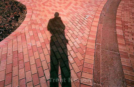 Trent Nelson shadow on bricks at the Shriners Hospital for Children.<br />