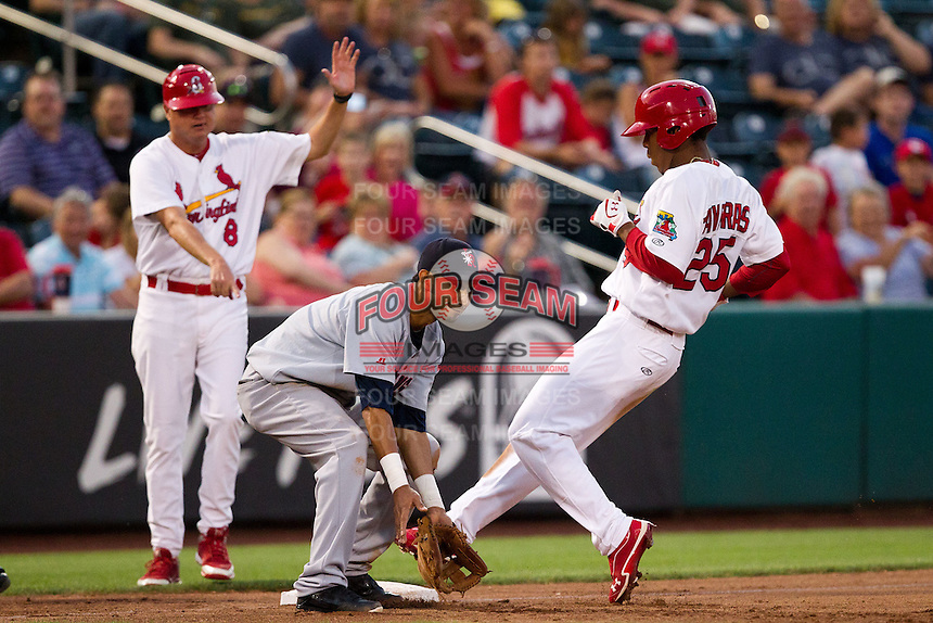 Oscar Taveras (25) of the Springfield Cardinals stands on third base after hitting a triple during a game against the Arkansas Travelers at Hammons Field on June 13, 2012 in Springfield, Missouri. (David Welker/Four Seam Images)