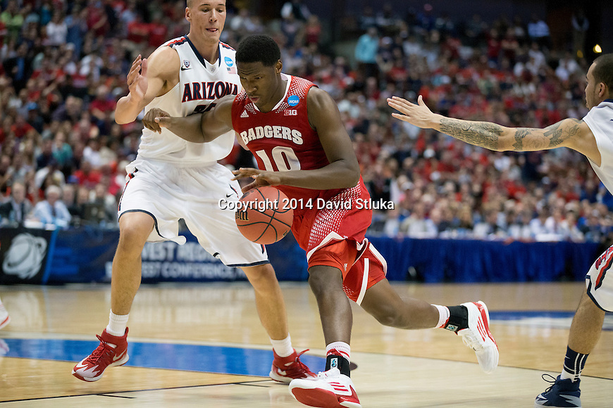 Wisconsin Badgers forward Nigel Hayes (10) drives to the hoop during the Western Regional Final NCAA college basketball tournament game against the Arizona Wildcats Saturday, March 29, 2014 in Anaheim, California. The Badgers won 64-63 (OT). (Photo by David Stluka)