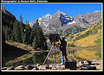 Old school photographer using a view camera at the Maroon Bells, Colorado. John offers autumn photo tours throughout Colorado.