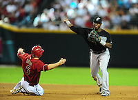 Jul. 11, 2010; Phoenix, AZ, USA; Florida Marlins shortstop Hamley Ramirez throws to first base to complete the double play after forcing out Arizona Diamondbacks base runner Stephen Drew in the fourth inning at Chase Field. Mandatory Credit: Mark J. Rebilas-