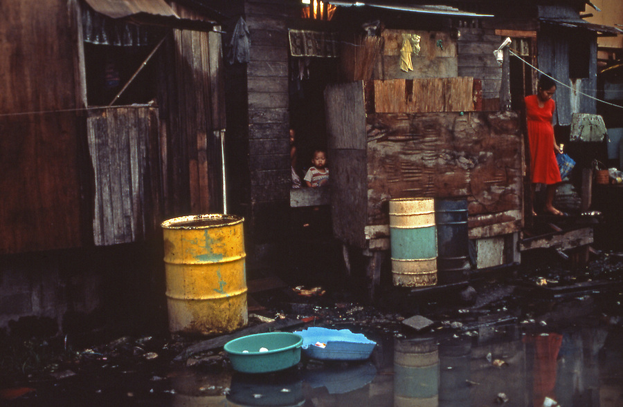 Houses made of wood scraps and salvaged corrugated steel for slum dwellers in Tondo, Manila, Philippines