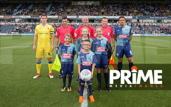 Captains Tom Lockyer of Bristol Rovers, Adam El-Abd of Wycombe ,officials (referee Kevin Johnson, linesmen Andrew Laver & Anthony Da Costa) & mascots  during the Sky Bet League 1 match between Wycombe Wanderers and Bristol Rovers at Adams Park, High Wycombe, England on 18 August 2018. Photo by Andy Rowland.
