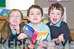 Book worms: Amy Moriarty, Denis Costello and Domhnall Dowling getting stuck into a good book at Killahan National School, Abbeydorney on Friday morning in celebration of World Book Day.   Copyright Kerry's Eye 2008