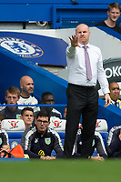 Burnley manager Sean Dyche shouts instructions to his team from the dug-out <br /> <br /> Photographer Craig Mercer/CameraSport<br /> <br /> The Premier League - Chelsea v Burnley - Saturday August 12th 2017 - Stamford Bridge - London<br /> <br /> World Copyright &copy; 2017 CameraSport. All rights reserved. 43 Linden Ave. Countesthorpe. Leicester. England. LE8 5PG - Tel: +44 (0) 116 277 4147 - admin@camerasport.com - www.camerasport.com