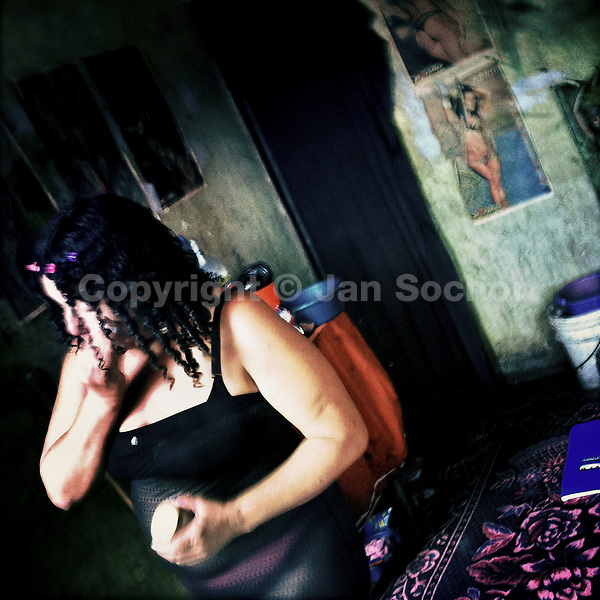 A Salvadorean sex worker prepares herself for a day shift during a busy week before Christmas when men get paid, in San Salvador, El Salvador, 18 December 2013.