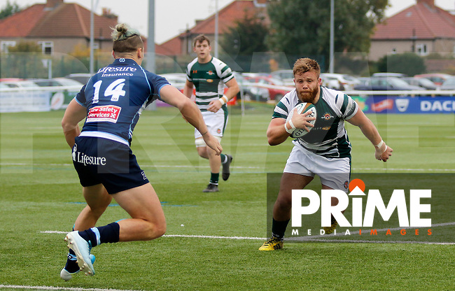 Ealing's Rhys Lawrence is faced by Bedford's Patrick Tabley during the Greene King IPA Championship match between Ealing Trailfinders and Bedford Blues at Castle Bar , West Ealing , England  on 29 October 2016. Photo by Carlton Myrie / PRiME Media