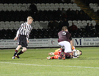 Alan Combe catches as jack Smith (left) and Dennis Prychenaco look on in the St Mirren v Heart of Midlothian Clydesdale Bank Scottish Premier League U20 match played at St Mirren Park, Paisley on 6.11.12.