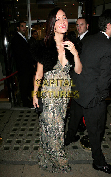 LINZI STOPPARD.The White Room - charity fundraiser, Flawless & Co, New Bond Street, London, England..November 8th, 2007.full length black wrap shrug beige brown pattern dress clutch bag purse hand.CAP/AH.©Adam Houghton/Capital Pictures.