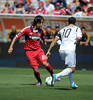 Chicago midfielder Rafael Robayo (88) cuts the ball back against LA Galaxy midfielder Landon Donovan (10).  The LA Galaxy defeated the Chicago Fire 2-0 at Toyota Park in Bridgeview, IL on July 8, 2012.