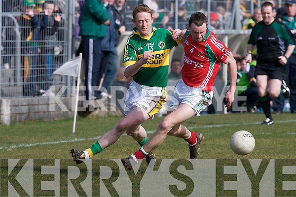 Kerry's Colm Cooper and Mayo's Keith Higgins.