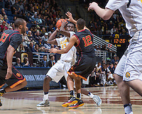 California's Jabari Bird controlling the ball away from USC's Julian Jacobs during a game at Haas Pavilion in Berkeley, California on February 23th, 2014. California defeated USC 77 - 64
