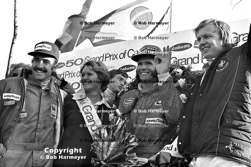 Clay Regazzoni, Emerson Fittipaldi and Ronnie Peterson (L-R) with 'Miss Grand Prix' in victory lane at the 1974 Canadian Grand Prix at Mosport Park. Fittipaldi, Regazzoni and Peterson finished first, second and third, respectively, and Fittipaldi beat Regazzoni for the World Championship by just three points.