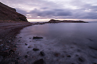 The shoreline curves gently at Second Valley, and a long exposure softens the waves which break against the rocky beach.