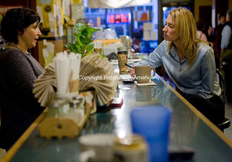 TORRINGTON, CT - 09 FEBRUARY 2009 -020909JT03-<br /> Diane Persechino, left, owner of Chiane's Coffee House in downtown Torrington, voices her concerns to newly elected Rep. Michelle Cook (D-65th) at the coffee house, where Cook was available to meet with her constituents on Monday afternoon.<br /> Josalee Thrift / Republican-American