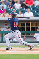 Todd Cunningham (20) of the Gwinnett Braves follows through on his swing against the Charlotte Knights at BB&T Ballpark on August 6, 2014 in Charlotte, North Carolina.  The Knights defeated the Braves  12-10.  (Brian Westerholt/Four Seam Images)