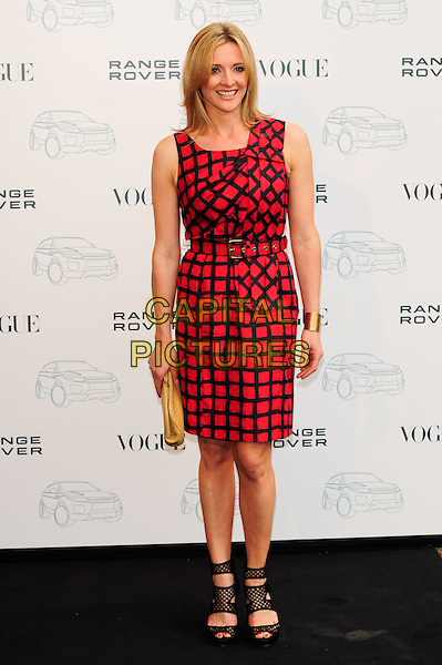 GABY LOGAN.Attends the Range Rover 40th Anniversary Party in association with Vogue at the Orangery, Kensington Palace, London, England, UK..July 1st 2010.full length black red print belt shift dress sleeveless cut out cage shoes peep toe gold clutch bag .CAP/CJ.©Chris Joseph/Capital Pictures.