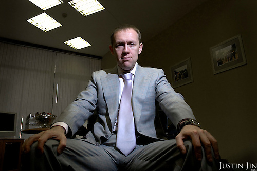 Andrei Lugovoy poses in his office in Moscow. Lugovoy, now a member of the Russian parliament, is the chief suspect in the murder by polonium of former FSB office Alexander Litvinenko in London.