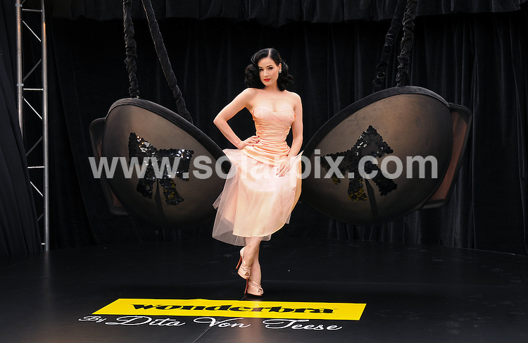 **ALL ROUND EXCLUSIVE PICTURES FROM SOLARPIX.COM**.**WORLDWIDE SYNDICATION RIGHTS**.Wonderbra by Dita Von Teese : The Collection Unveiled, photocall at Covent Garden, London.  Tuesday September 23, 2008...JOB REF: 23_09_2008 SSD     DATE: 23_09_2008.**MUST CREDIT SOLARPIX.COM OR DOUBLE FEE WILL BE CHARGED* *UNDER NO CIRCUMSTANCES IS THIS IMAGE TO BE REPRODUCED FOR ANY ONLINE EDITION WITHOUT PRIOR PERMISSION*
