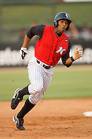 Kyle Colligan #23 of the Kannapolis Intimidators hustles towards third base against the Delmarva Shorebirds at Fieldcrest Cannon Stadium May 14, 2010, in Kannapolis, North Carolina.  Photo by Brian Westerholt / Four Seam Images