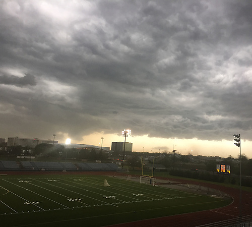 The press box at Mitchel Athletic Complex affords a view of ominous skies looming above during the Nassau-Suffolk CHSAA varsity boys lacrosse Class AA final between St. Anthony's and Chaminade on Tuesday, May 15, 2018. The game went to halftme tied 8-8 when a prolonged lightning storm forced a postponement.