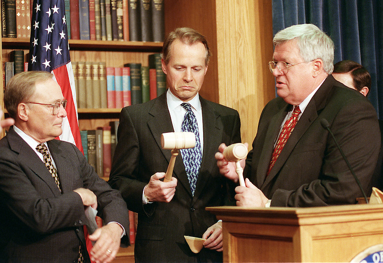 5/24/00.CHINA TRADE--During a news conference with other pro-PNTR Republicans after final passage of permanent normal trade relations with China, David Dreier, R-Calif., admires a gavel given him by House Speaker J. Dennis Hastert, R-Ill., in appreciation for his efforts on the bill. Ways & Means Chairman Bill Archer, R-Texas, looks on. The other gavel was for Philip Crane, R-Ill. (not pictured)..CONGRESSIONAL QUARTERLY PHOTO BY SCOTT J. FERRELL