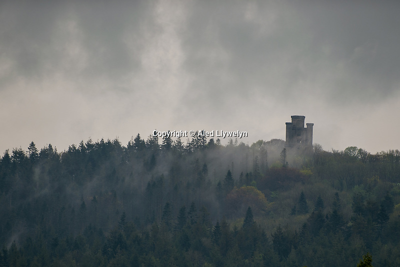 Mist rises at Paxtons Tower near Llanarthne, Wales, UK