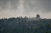 Mist rises at Paxtons Tower near Llanarthne, Wales, UK