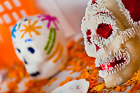 Decorated sugar sculls are placed at the altar of the dead (altar de muertos), a religious site honoring the deceased, during the Day of the Dead celebration in Morelia, Michoacán, Mexico, 1 November 2014. Day of the Dead ('Día de Muertos') is a syncretic religious holiday, celebrated throughout Mexico, combining the death veneration rituals of the ancient Aztec culture with the Catholic practice. Based on the belief that the souls of the departed may come back to this world on that day, people gather on the gravesites praying, drinking and playing music, to joyfully remember friends or family members who have died and to support their souls on the spiritual journey.