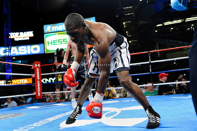 Bronx, New York, June 5th, 2010:  Joe Greene is knocked down (his glove touched the canvas) during his Super Welterweight fight against Vanes Martirosyan at the new Yankee Stadium. Martirosyan won by unanimous decision. Photo by Thierry Gourjon.