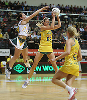 25.10.2012 Australia's Caitlin Bassett and South Africa's Amanda Mynhardt in action during the England v Australia netball test match as part of the Quad Series played at the TSB Arena Wellington. Mandatory Photo Credit ©Michael Bradley.