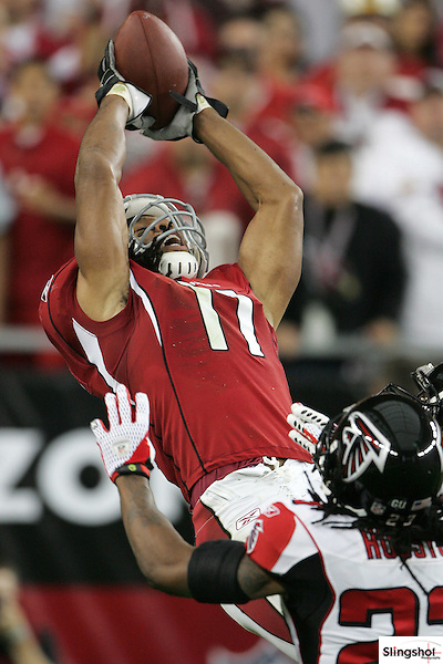Arizona Cardinals wide receiver Larry Fitzgerald jumps and makes an electrifying touchdown catch for the first score of a playoff game against the Atlanta Falcons on January 3rd, 2009 at the University of Phoenix Stadium in Glendale, AZ.