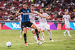 FC Internazionale Forward Ivan Perisic (L) in action against Bayern Munich Forward Thomas Muller (C) during the International Champions Cup match between FC Bayern and FC Internazionale at National Stadium on July 27, 2017 in Singapore. Photo by Weixiang Lim / Power Sport Images