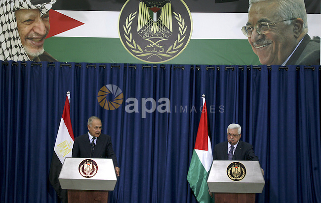 Palestinian President Mahmoud Abbas speaks during a joint press conference with Egyptian Foreign Minister Ahmed Aboul Gheit, in the West Bank city of Ramallah, Thursday, Oct. 28, 2010. Egypt's foreign minister says there has been no breakthrough in restarting Israeli-Palestinian talks, which have run aground over Israeli settlement building. Aboul Gheit is on an official visit to the region. Photo by Eyad Jadallah