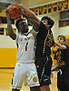 Jon Harewood #1 of St. Anthony's, left, drains a basket and draws a foul for a three-point play during a non-league varsity boys basketball game against Ward Melville at St. Anthony's High School on Thursday, Dec. 15, 2016. St. Anthony's won by a score of 52-48.