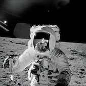 "On the Moon - (FILE) -- Apollo 12 astronaut Alan Bean holds a special environmental sample container filled with lunar soil collected during his sojourn on the lunar surface. A Hasselblad camera is mounted on the chest of his spacesuit. Pete Conrad, who took this image, is reflected in Bean's helmet visor, Nov. 20, 1969.  This photo is part of the book ""Apollo: Through the Eyes of the Astronauts"" published to commemorate the 40th anniversary of the first manned lunar landing on July 20, 1969..Credit: Pete Conrad - NASA via CNP"