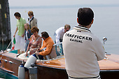 Holidaymakers disembark from a pleasure boat on Lake Garda.