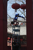 A Chinese acrobat performs at a temple fair to celebrate the Lunar New Year of the Tiger on February 15, 2010 in Beijing, China.