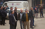 (Tuzla, Bosnia, 02/07/02) Men gather at an intersection as a Massachusetts Army National Guard convoys passes through town while maintaining order in the aftermath of ethnic cleansing and preventing a resumption of violence that ravaged the former Yugoslav state by provide security for displaced residents returning to rebuild their shattered homes in Northern Bosnia on Thursday, February 07, 2002. Staff photo by Christopher Evans
