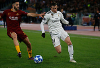 Gareth Bale of Real Madrid and Bryan Cristante of AS Roma  during the Champions League Group  soccer match between AS Roma - Real Madrid  at the Stadio Olimpico in Rome Italy 27 November 2018
