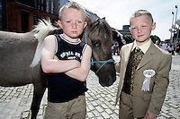 8 year old Felix Moorehouse (right) just made his first holy communion he is pictured with his 8 year old uncle Dane Moorehouse both from Shankill at the Smithfield Horse Market,  Dublin, Ireland looking to buy a pony with the money he raised from his communion fund..Picture James Horan.