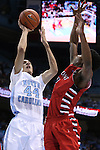 07 November 2014: North Carolina's Justin Jackson (44) and Belmont Abbey's Markel Pollard (right). The University of North Carolina Tar Heels played the Belmont Abbey College Crusaders in an NCAA Division I Men's basketball exhibition game at the Dean E. Smith Center in Chapel Hill, North Carolina. UNC won the game 112-34.