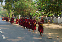 Monks collecting their Aaims  in Hpa An, Myanmar, Burma
