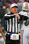 9 December 2007: NFL Referee Scott Green  calls a play during a game between the Miami Dolphins and the Buffalo Bills at Ralph Wilson Stadium in Orchard Park, NY. The Bills defeated the Dolphins 38-17. ..Mandatory Photo Credit: Ed Wolfstein Photo